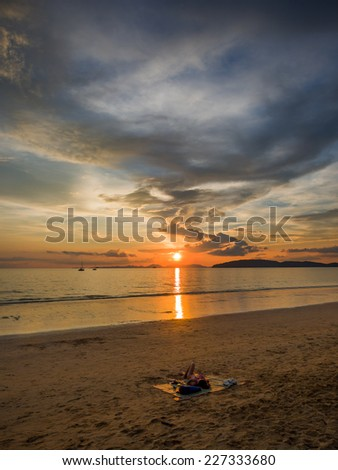 Woman on the beach at  Sunset in Krabi Thailand  - stock photo