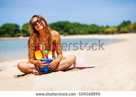 Woman on the beach, bali - stock photo