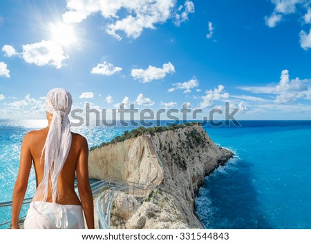 Woman on the beach looking  over Porto Katsiki beach in Lefkas island Greece