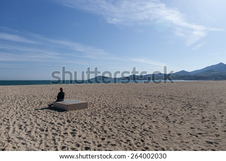 Woman on the beach of Argeles plage - stock photo