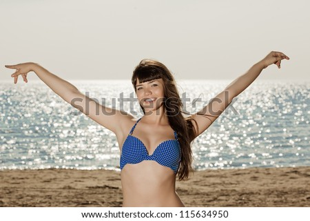 Woman on the beach. Young beautiful girl on the sand by the sea. - stock photo