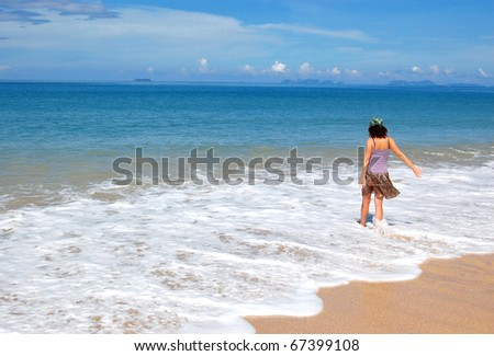 Woman on the beautiful tropical beach