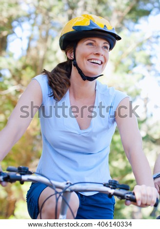 woman on the bike outdoor - stock photo