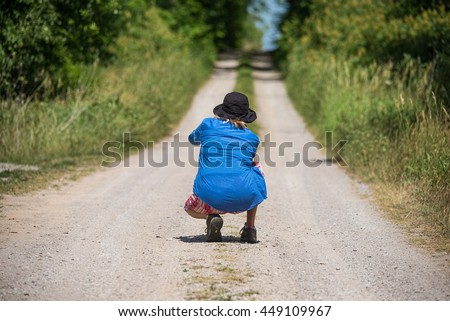 Woman on the country road
