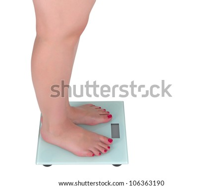 Woman on the digital scale with display, white background - stock photo