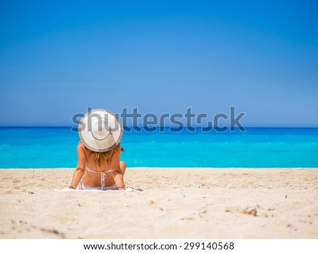 WOman on The famous Navagio Shipwreck beach in Zakynthos island Greece - stock photo