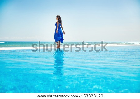 woman on the infinite water - freedom concept - stock photo