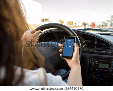 woman on the smartphone and driving a car in danger concept - stock photo