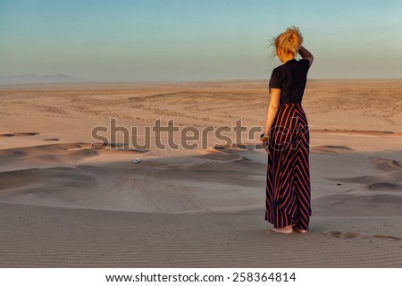 Woman on the top of dune in Namibia - stock photo