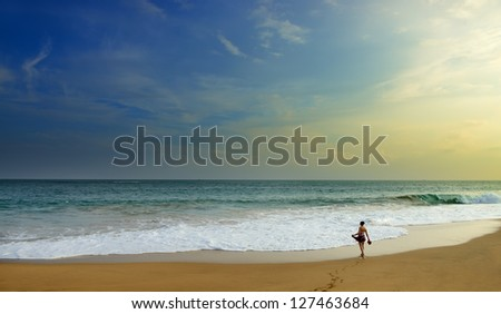 woman on the wide beach of the ocean. Beautiful shores of the Indian ocean