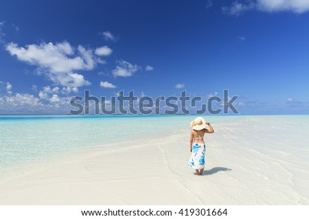 Woman on tropical island, South Male Atoll, Kaafu Atoll, Maldives