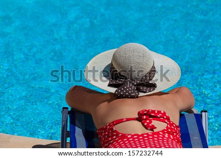 woman on vacation by the pool - stock photo