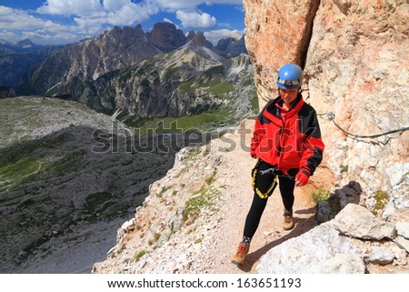 Woman on via ferrata to Monte Paterno, Dolomite Alps, Italy