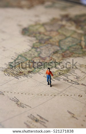 woman on vintage world map