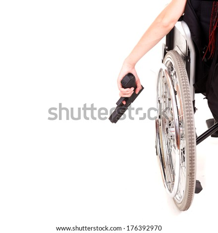 woman on wheelchair with gun, white background - stock photo
