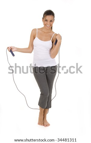 Woman on white holding a jump rope. - stock photo