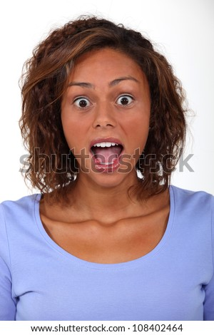 Woman open mouthed in surprise - stock photo