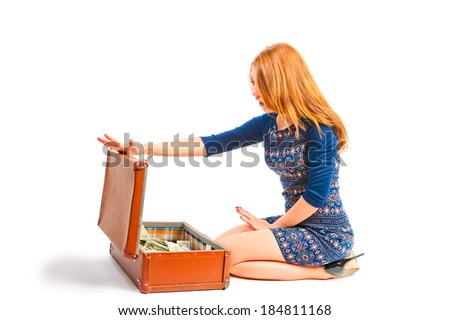 woman opened the suitcase full of money