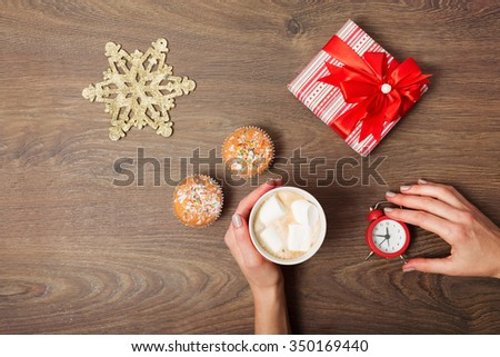 Woman opening gift box on the Christmas background