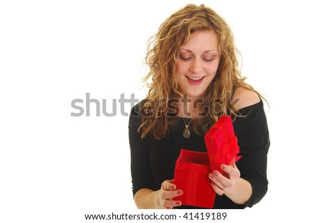 Woman opening red gift isolated on white. - stock photo