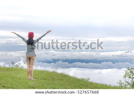 Woman Opens Her Arm, Enjoy the Fresh Air and Beautiful Nature on Green Grass in Thailand