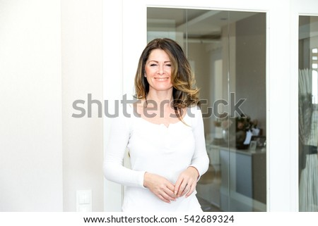 Woman opens the door