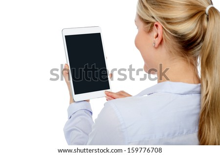 Woman operating new tablet device
