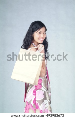 Woman or chinese woman with shopping bag