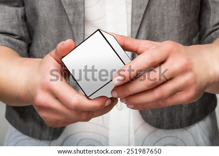 Woman or female hands holding white cube - stock photo