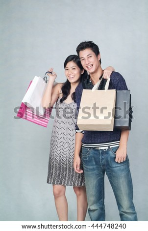 Woman or mixed couple shopping on background - stock photo