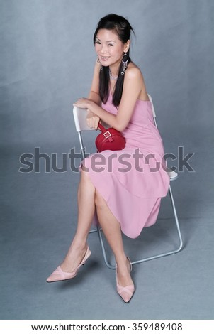 Woman or Shopping woman sitting on chair and holding bags