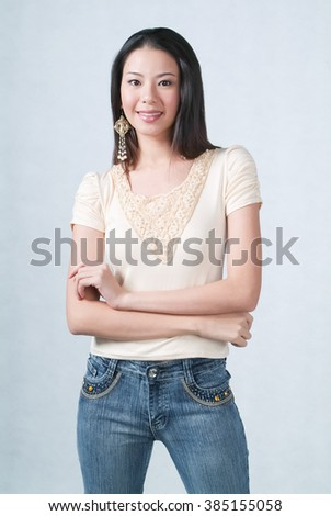Woman or woman crossed arms on background - stock photo