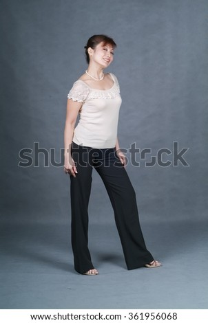 Woman or woman presenting on the background - stock photo