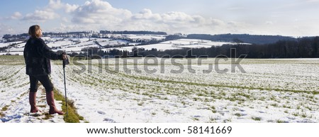 Woman Out For Walk During The Winter - stock photo