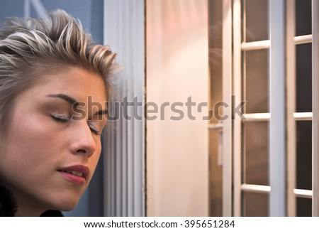 woman outdoor in a city on shopping tourclosed eyes - stock photo