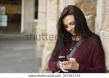 woman outdoors talking on mobile phone - stock photo