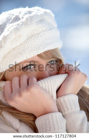 Woman outdoors wearing winter clothing - stock photo