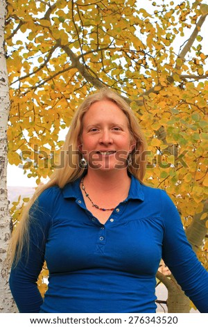 Woman outdoors with yellow autumn leaves, Utah, USA. - stock photo