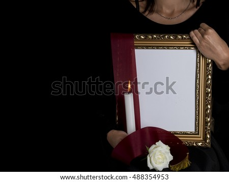 woman outflank blank mourning frame with sympathy flower