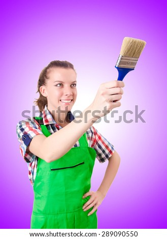 Woman painter with paintbrush against gradient