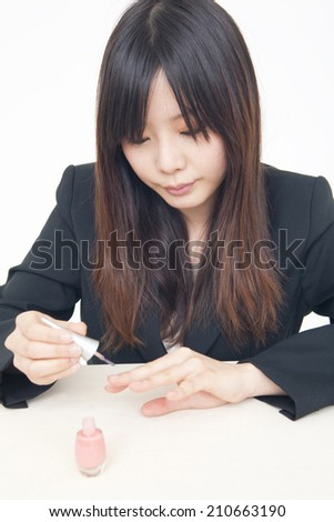 Woman Painting A Manicure