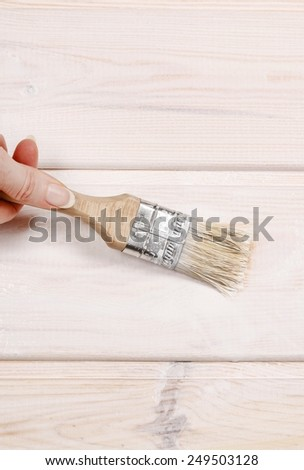 Woman painting wood  - stock photo