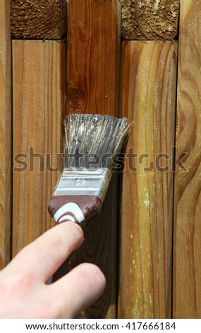 Woman painting wooden furniture piece - stock photo