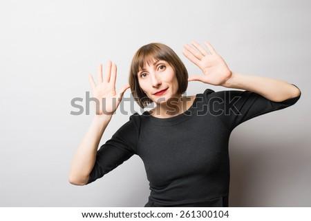 woman palms forward - stock photo