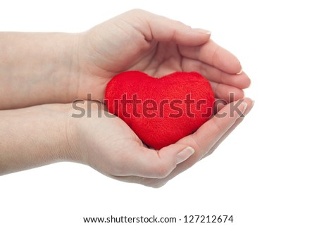 Woman palms protecting red heart - health or love concept