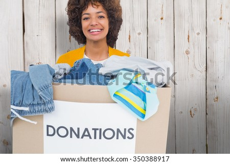 Woman participating at charity against wooden background