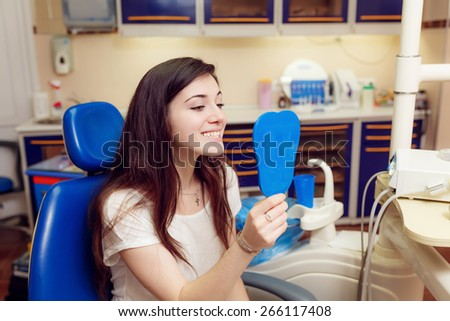 Woman patient at dentist consultation - stock photo