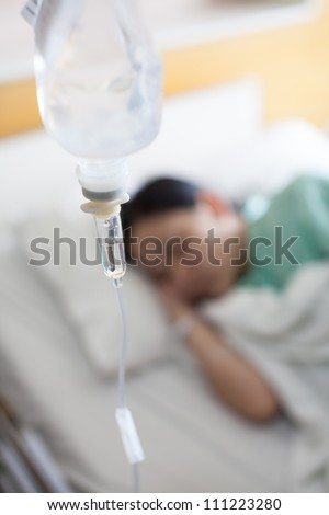 Woman patient sleeping in hospital bed - stock photo