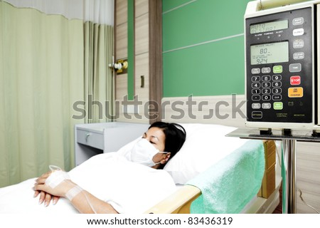 Woman patient sleeping in hospital bed