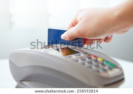 Woman pay by credit card in shop - stock photo